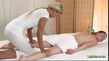 brunette gets feet and boobs massage