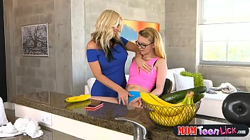 stepmom busts horny teen and helps her out.
