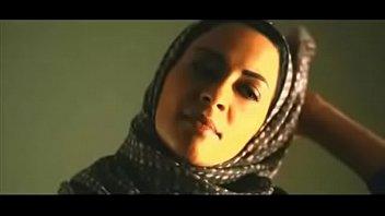 muslim woman removes hijab to kiss.