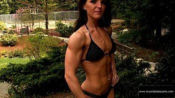 amber jacobs black bikini side biceps