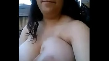 Mexican girl shows off massive tits in yard