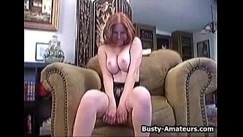 busty ginger sucking her own tits.