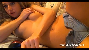 cute webcam teen inserts a finger into her.