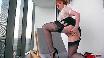 redhead office slut plays with her.