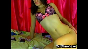 beautiful cam girl rubs her clit