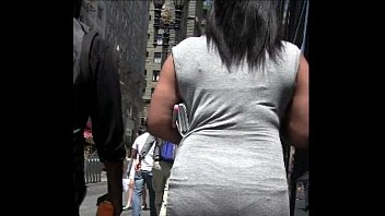 candid black woman tight dress street.