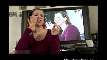 slutty brunette babe smokes a cigarette