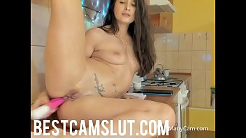 sexy girl squirts in the kitchen.