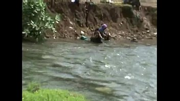 lady open bath and cloth changing in river.