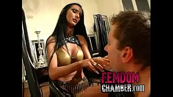 dominatrix trains her male slave strapon.
