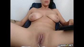 big tit milf rubs pussy on webcam.