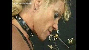blond slave with nice big tits sits down.