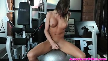 busty transwoman tugs cock after working.