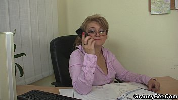 office mature in white stockings seduces.
