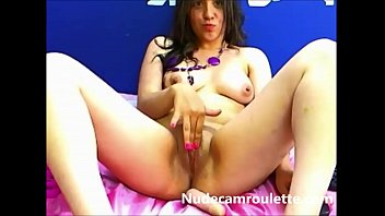 beautiful brunette playing with her pussy on cam.