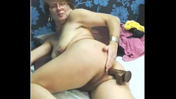 sexy granny uses dildo toy anal.