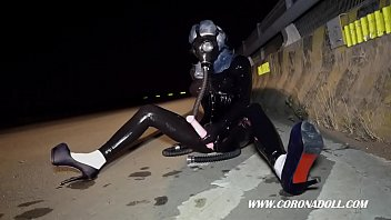 wearing black latex in public &amp_ gas mask.