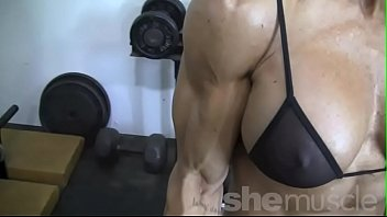 sexy blonde female bodybuilder in see through top.