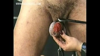 mistress wearing leather drips hot candle wax over.