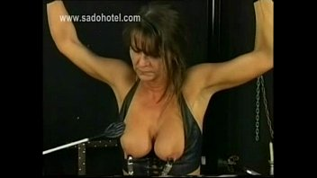 tied up slave in leather got metal clamps.