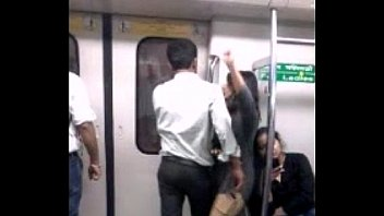 desperate lovers in delhi metro kiss n boob.