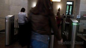 upskirt of a slender girl on an escalator.