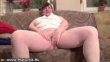 very busty old mom is stripping