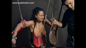 two tied horny slaves with their bodies covered.