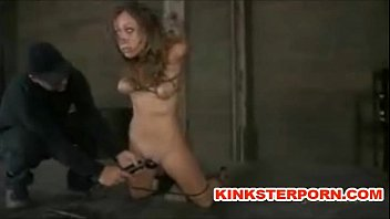 bdsm slave locked in punishment device.