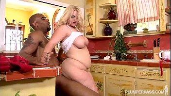 blonde in kitchen takes big black cock in.