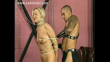 horny blond slave with nice tits gets spanks.