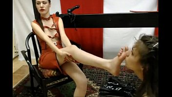 slave licks masters feet - more.