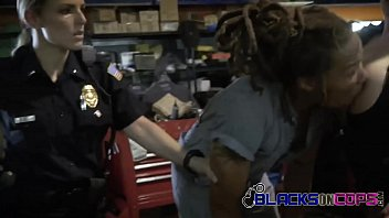 female officers search mechanic shop when they find.