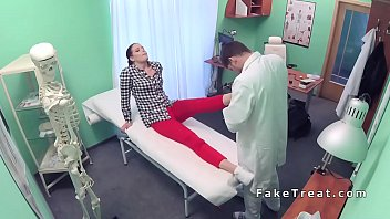 doctor worships feet to brunette patient
