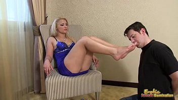 slave licks his mistress shoes and.