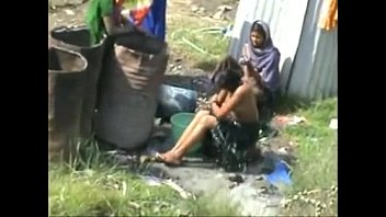 indian village women bathing nude in open caught.