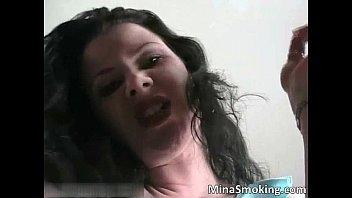hot brunette slut smokes cigarette
