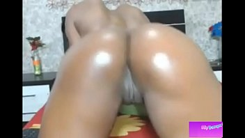 oiled black colombian girl dancing and shaking her.