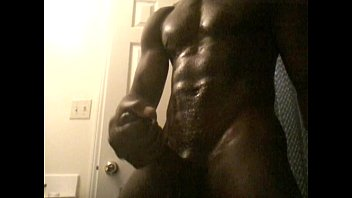 ** oiled chocolate man beats his long dick.
