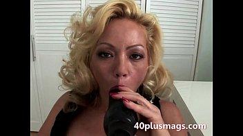 curly blonde sucking black toy