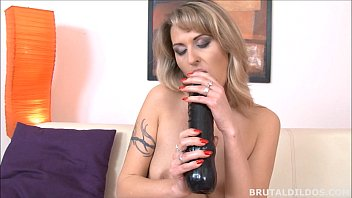 tattood blonde laura cumming from a really thick dildo