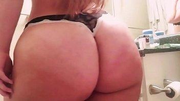 bbw big booty blonde brushing teeth in mirror.