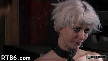 shackled darling gets excruciating caning on her skinny body