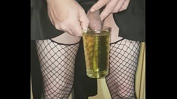 crossdressing sissy drinks his own piss and swollows.