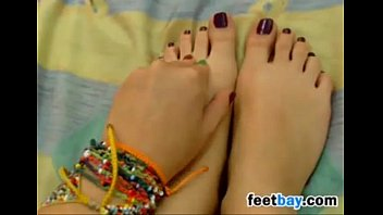 sweet girl teases her beautiful feet