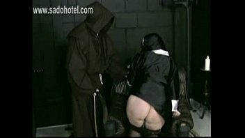 master priest pulls skirt up and panties down.