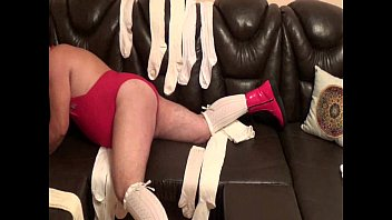 self spanking man in red boots and white.