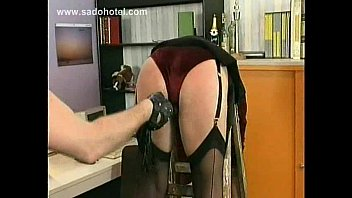milf secretary slave is spanked in de office.