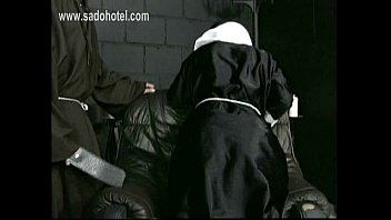 naughty nun kneeling on a chair with her.