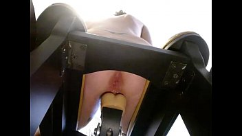 amateur webcam girl riding toy on a chair.
